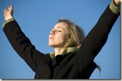 iStock_000003267787XSmall-young woman praising God